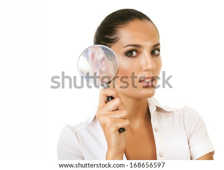 business woman with magnifying glass on ear on white background - stock photo