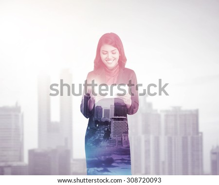 Business woman with multiple exposure holding tablet computer. Business technology concept - stock photo