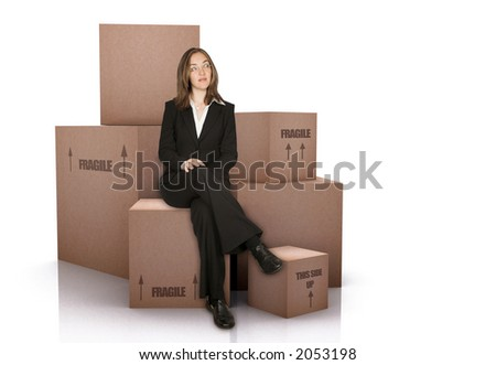 business woman with packed cardboard boxes over a white background - stock photo