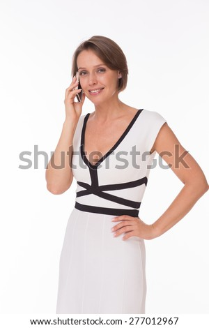 Business woman with phone isolated on white - stock photo
