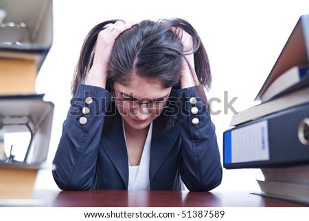 Business woman with pile of folders and binders looking desperate. - stock photo