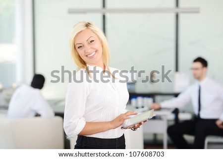 Business woman with tablet - stock photo
