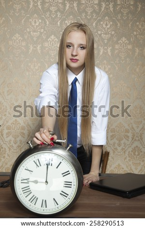 business woman with the clock - stock photo