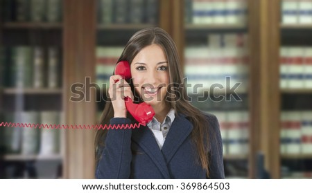 Business woman with vintage red phone - stock photo