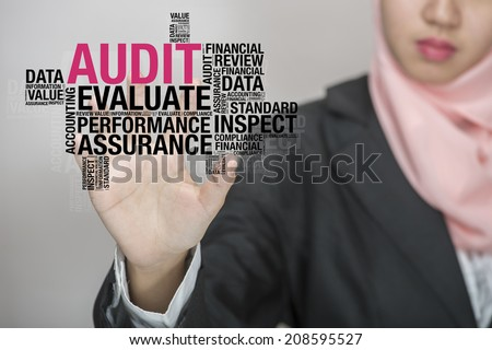 Business woman with virtual interface of Audit wordcloud - stock photo