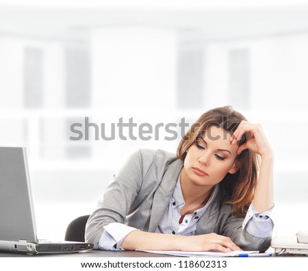 Business woman working in office on white - stock photo