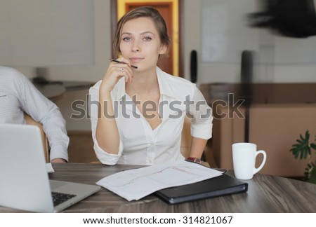 Business woman working in the office - stock photo
