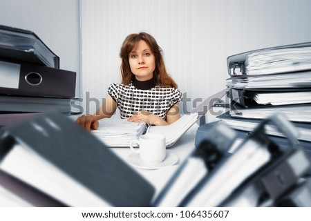 Business woman working in the office with accounting documents - stock photo