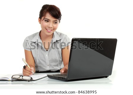 Business woman working on laptop computer isolated over white background - stock photo