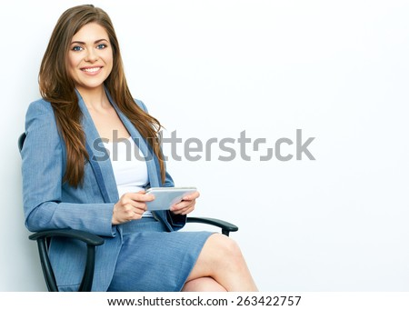 Business Woman Working with tablet, pad. Sitting in chair. isolated on white background portrait of smiling business woman. - stock photo