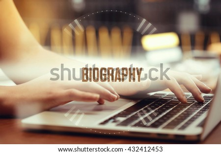 Business woman writing Biography on the computer - stock photo