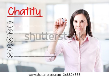 Business woman writing blank Charity list. Office background.  - stock photo