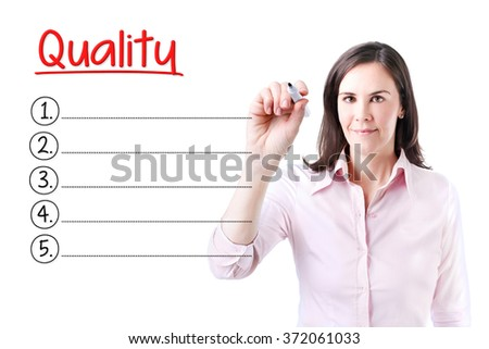 Business woman writing blank Quality list. Isolated on white.  - stock photo