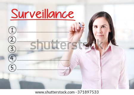 Business woman writing blank Surveillance list.Office background.  - stock photo