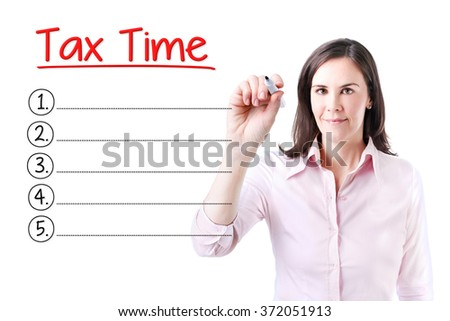 Business woman writing blank Tax Time list. Isolated on white.  - stock photo