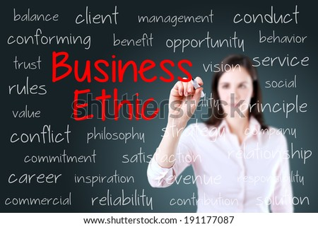 Business woman writing business ethic concept. Blue background. - stock photo