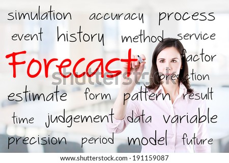 Business woman writing forecast concept. Office background.  - stock photo