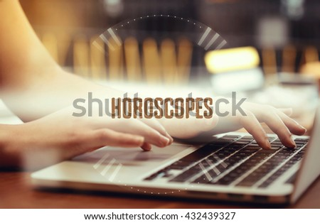 Business woman writing Horoscopes on the computer - stock photo