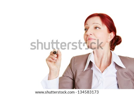 Business woman writing with pen into the air - stock photo