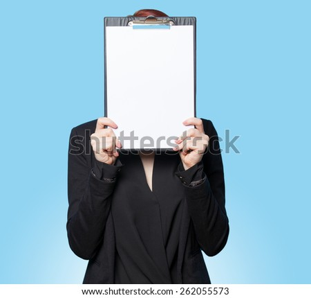 Business women hiding behind tablet on blue background - stock photo