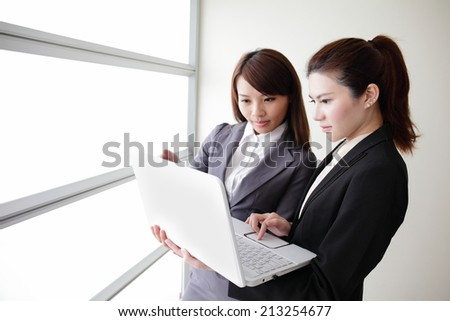 Business women look and smile conversation with computer in Office, asian - stock photo