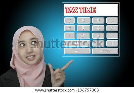 "Business Women pointing virtual calculator interface written ""tax Time"" - stock photo"
