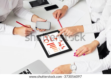 Business women using tablet computer in meeting - stock photo