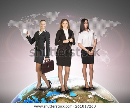 Business womens in suits, blouses, skirts, smiling and looking at camera. Against background of world map and globe. Elements of this image furnished by NASA - stock photo