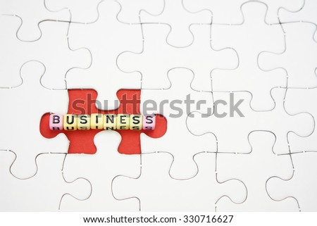 business word blocks arrangement concept on jigsaw puzzle - stock photo