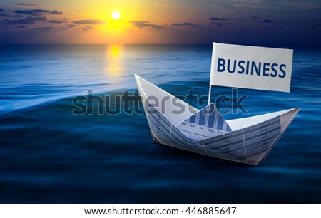 Business  word with boat made from business paper graph on sea and sun light.For business concept and financial concept ideas. - stock photo