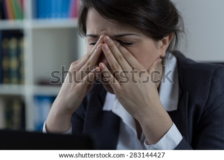 Business worker at office with sinus pain - stock photo