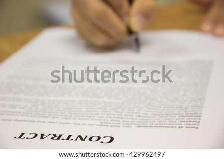 Business worker signing the contract to conclude a deal. selected focus. - stock photo