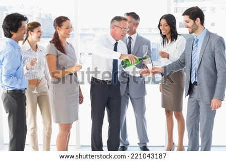 Business workers having a party and celebrating - stock photo