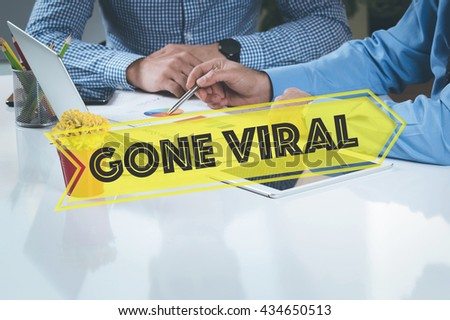 BUSINESS WORKING OFFICE Gone Viral TEAMWORK BRAINSTORMING TECHNOLOGY CONCEPT - stock photo