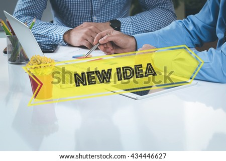 BUSINESS WORKING OFFICE New Idea TEAMWORK BRAINSTORMING CONCEPT - stock photo