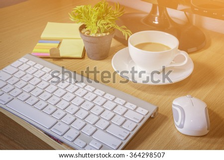 Business , Working on an Office Desk,Gadgets and supplies necessary for modern business,vintage color selective focus. - stock photo