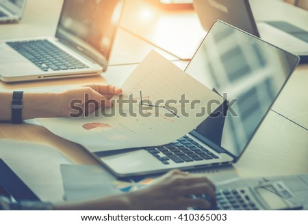 businessgirl working on Desk office business financial accounting calculate, Graph analysis - stock photo