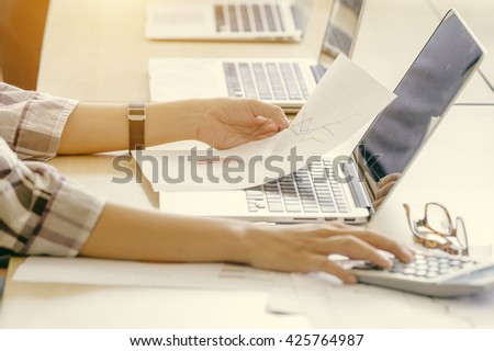 businessgirl working on Desk office business financial accounting calculate, Graph analysis, vintage colore - stock photo