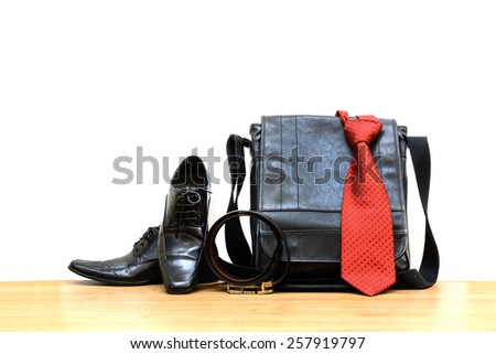Businessman accessories on wooden floor with copy space - stock photo