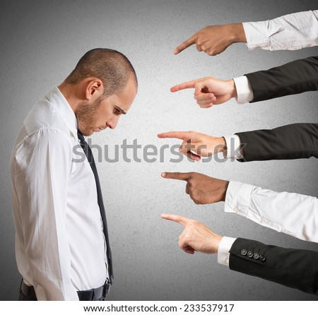 Businessman accused with hands that indicate - stock photo