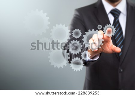 Businessman Activate Gears, touch Screen Concept - stock photo
