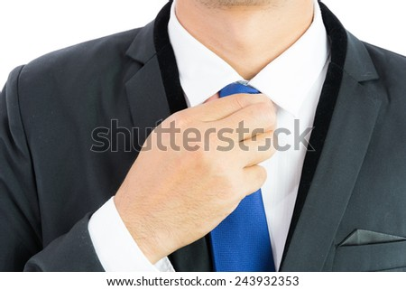 Businessman adjusting necktie isolated on over white background - stock photo