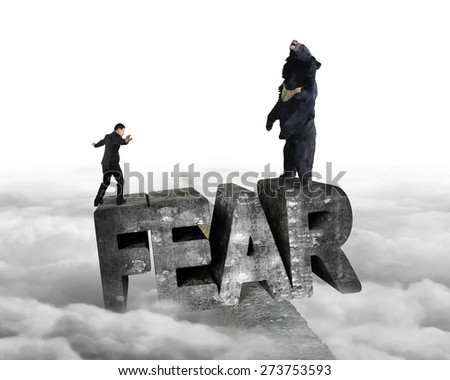 Businessman against black bear standing on fear 3D mottled concrete word, balancing on ridge with cloudy sky background - stock photo