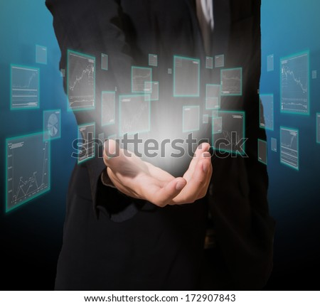 businessman analysis graph on screen high technology in hand - stock photo