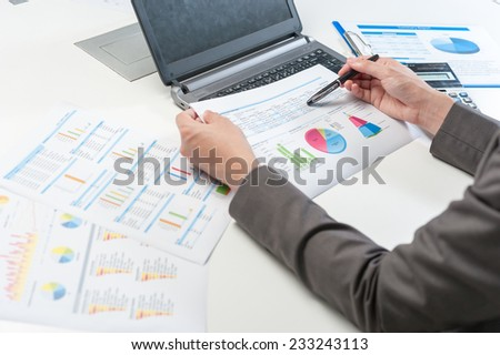 Businessman analyzing report, business performance concept - stock photo