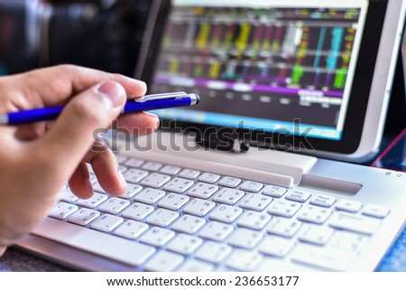 Businessman Analyzing Stock Market Status On Digital Tablet - stock photo