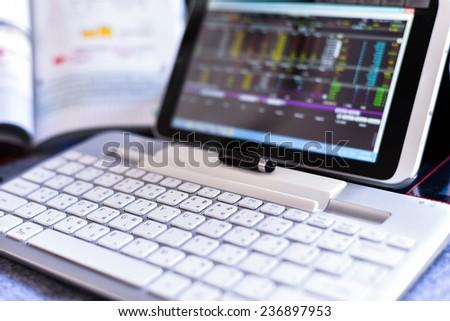 Businessman Analyzing Stock Market Status On Digital Tablet - stock photo