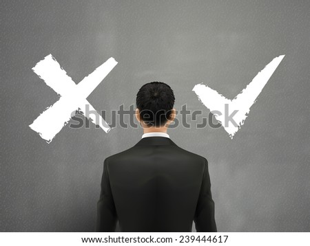 businessman and a choice of yes or no over grey - stock photo