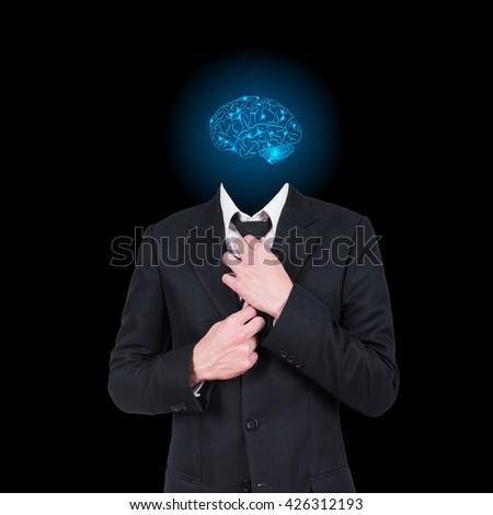 Businessman and brain on black background - stock photo