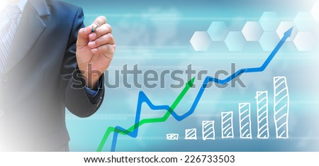 businessman and business graph on a touch screen interface  - stock photo